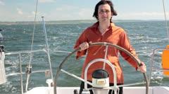 Yacht helmsman Stock Footage