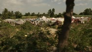 Driving Past Haiti Tent City Stock Footage