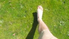 Walking Barefoot in Grass Stock Footage