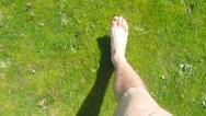 Stock Video Footage of Walking Barefoot in Grass