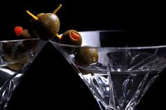 Stock Photo of Two martinis on black with olives