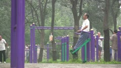 Senior citizens exercise to stay fit in a park in Beijing China Stock Footage
