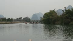 Moving Guilin China floating down river on bamboo raft  beautiful mountain Stock Footage