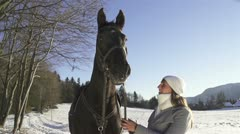 Portrait of girl and her horse in winter land Stock Footage