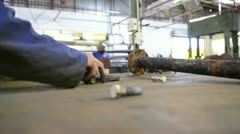 An industrial service repairmen labouring in workshop Stock Footage