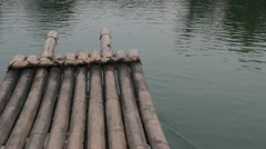 Guilin China floating down flowing river water on bamboo raft  beautiful Stock Footage