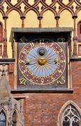 clock on town hall in wroclaw - stock photo