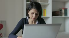 Beautifull woman works on the laptop Stock Footage