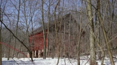 Abandoned 1910 rural homestead - red barn with stone foundation Stock Footage
