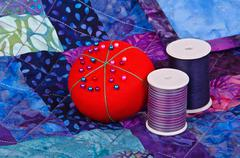 Quilt with quilting thread and pincushion Stock Photos