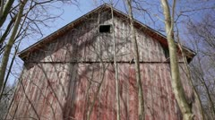Abandoned 1910 rural homestead - red barn, low angle Stock Footage