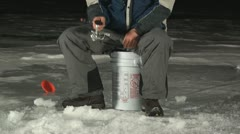 Man ice fishing at night 3 Stock Footage