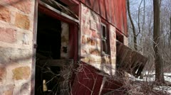 Abandoned 1910 rural homestead - red barn, close-up stone foundation Stock Footage