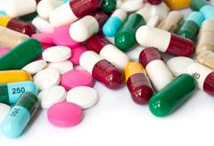 Colorful medical  pills and capsules. Stock Photos