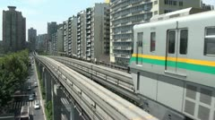 Chongqing monorail, transportation, renewable energy, city, China Stock Footage