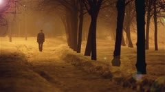 The young man walks in the alley, night, winter, foggy weather Stock Footage