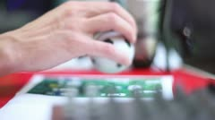 Male hand plays with mini football toy on table Stock Footage