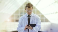 The engineer (or a doctor) watching, control process Stock Footage