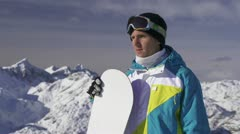Portrait of a male snowboarder in the mountains. Stock Footage