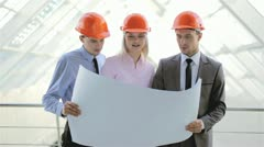 The builders (engineers) discuss the new project Stock Footage