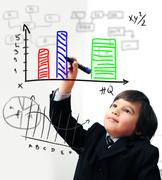 Child drawing  a diagram on digital screen Stock Photos