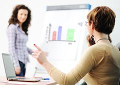 Questioning and answering while business presentation Stock Photos
