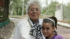 Older woman with her granddaughter - stock footage