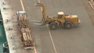 Stock Video Footage of logs taken off a truck