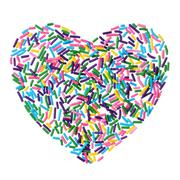 Colorful candy sprinkles heart isolated on white background Stock Photos