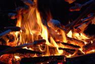 Barbecuing sausages at campfire Stock Photos