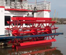 paddlewheel on back of ship - stock photo
