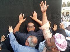 kaaba mecca in saudi arabia and muslim pilgrims comming for hajj - stock photo