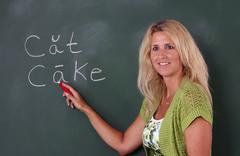 elementary teacher at chalkboard - stock photo