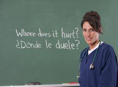 Nurse teacher translating english to spanish Stock Photos