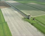 Stock Video Footage of Aerial shot Windmill turning in Schermer polder, The Netherlands 02