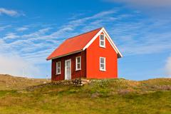 Bright red siding house in iceland Stock Photos