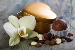 Handmade chocolates and flowers. Stock Photos