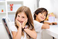 adorable kids brother and sister at home - stock photo