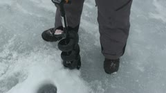 Drilling ice fishing hole 3 Stock Footage