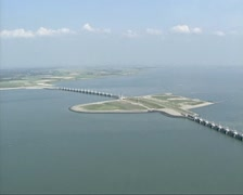 Aerial view from North Sea at Eastern Scheldt storm surge barrier Stock Footage