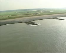 Aerial shot Dutch polder behind sea defence Hondsbossche Zeewering Stock Footage