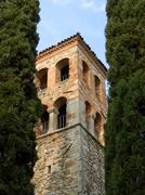Bell tower between cypresses Stock Photos