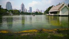 Lumphini Park in Bangkok with cityscape Stock Footage