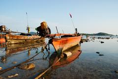 national fishing boats on the shore of the indian ocean phuket thailand - stock photo