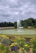 Formal garden, flowers and fountain, water jet   (France) Stock Photos