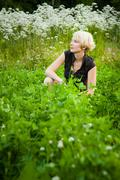 girl in a field of flowers - stock photo