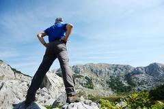 hiking to the top of hill, great success - stock photo