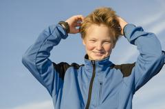 Kid adjusts his hair Stock Photos
