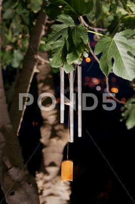 Stock photo of Wind chimes at night
