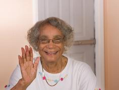 african american woman waving - stock photo